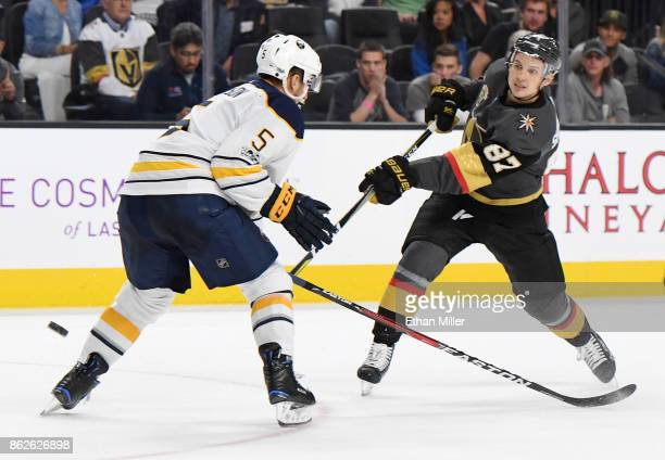 Vadim Shipachyov of the Vegas Golden Knights takes a shot against Matt Tennyson of the Buffalo Sabres in overtime of their game at TMobile Arena on...