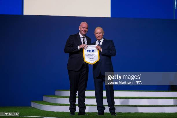 Vadimir Putin and Gianni Infantino pose during the 68th FIFA Congress at Expotsentr on June 13 2018 in Moscow Russia