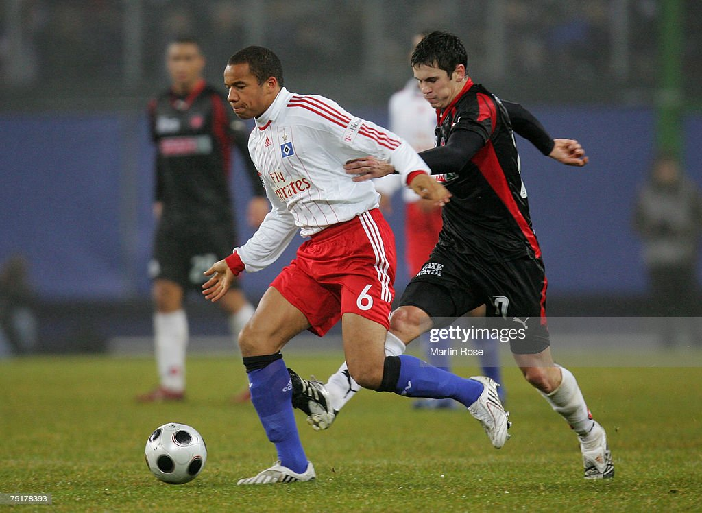 Vadis Odjidja (L) new player of Hamburg and George Furuseth (R) of Midtjyland compete for the ball during the friendly match between Hamburger SV and FC Midtjyland at the HSH Nordbank Arena on January 23, 2008 in Hamburg, Germany.