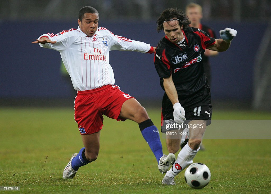 Vadis Odjidja (L) of Hamburg and Petter Furuseth (R) of Midtjyland compete for the ball during the friendly match between Hamburger SV and FC Midtjyland at the HSH Nordbank Arena on January 23, 2008 in Hamburg, Germany.