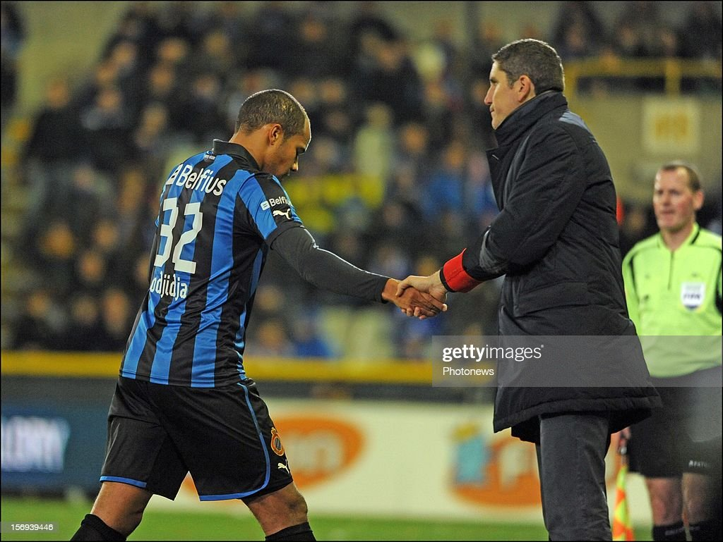 Vadis Odjidja Ofoe of Club Brugge KV sent off by referee Peter Vervecken after red card with head coach Juan Carlos Garrido of Club Brugge KV pictured during the Jupiler League match between Club Brugge K.V and R.C.S.Charleroi November 25, 2012 in Brugge, Belgium.