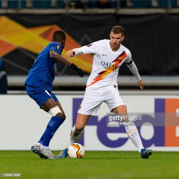 Vadis OdjidjaOfoe of KAA Gent and Edin Dzeko of AS Roma battle for the ball during the UEFA Europa League round of 32 second leg match between KAA...