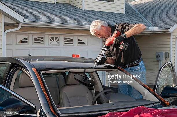 Vadnais Heights Minnesota A small business mobile glass service owner installing a new windshield on a new car Prepping for installation of the...