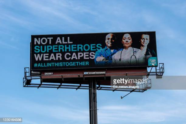 Vadnais Heights, Minnesota, Billboard related to the coronavirus pandemic says not all super heros wear capes.