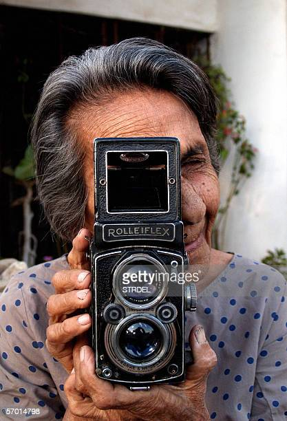 Indian photographer Homai Vyarawalla poses with her Rolleiflex camera at her home in Vadodara 06 March 2006 Ninetythree year old Homai lays claim to...