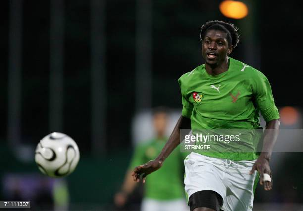 Togo's Sheyi Adebayor vies in a friendly football game against Liechtenstein in preparation for the 2006 World Cup 02 June 2006 in Vaduz AFP PHOTO...