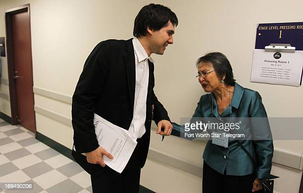 Vadym Kholodenko of the Ukraine is greeted by his host mother Imelda Casto after his performance during the second day of the preliminary round of...