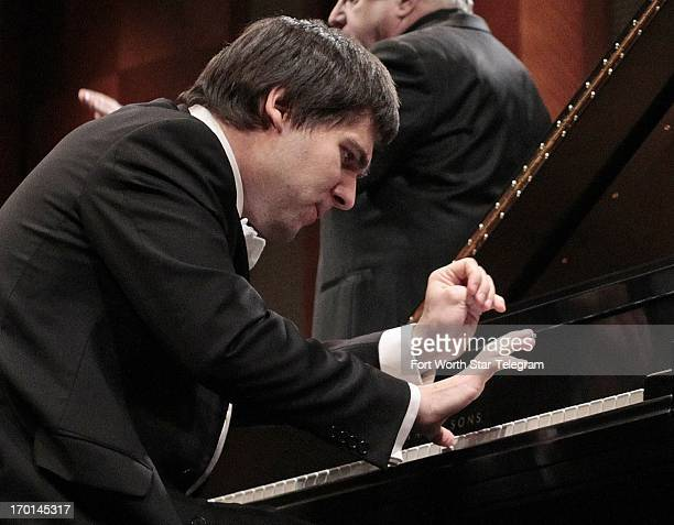 Vadym Kholodenko of the Ukraine plays a concerto with the Fort Worth Symphony Orchestra on the second day of finals in the 14th Van Cliburn...