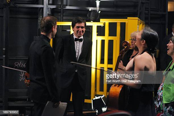 Vadym Kholodenko of the Ukraine talks backstage with members of the Brentano String Quartet before their performance during the first day of the...