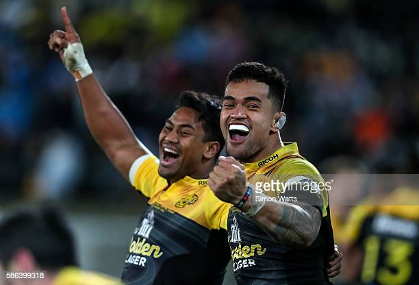 Vaea Fifita and Julian Savea celebrate after winning the 2016 Super Rugby Final match between the Hurricanes and the Lions at Westpac Stadium on...