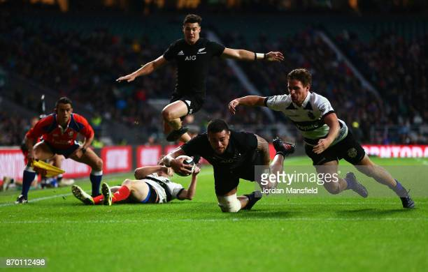 Vaea Fifita of New Zealand dives to touch down a try during the Killik Cup match between Barbarians and New Zealand at Twickenham Stadium on November...