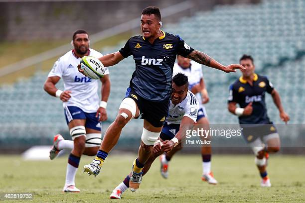 Vaea Fifita of the Hurricanes is tackled during the Super Rugby preseason match between the Blues and the Hurricanes at QBE Stadium on February 6...