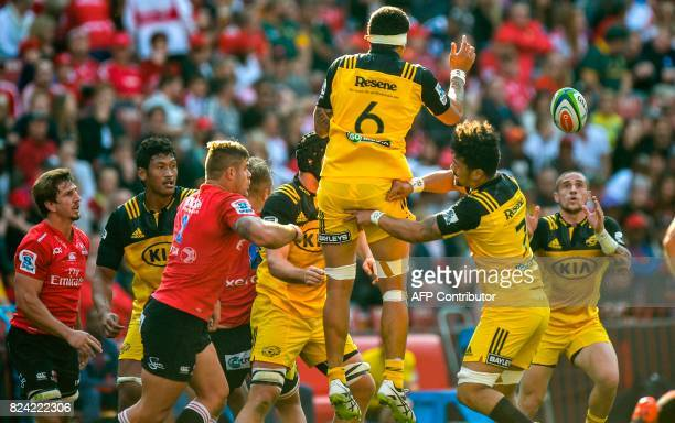 Vaea Fifita of the Hurricanes throws to TJ Perenara of the Hurricanes from the lineout during the Super Rugby semifinal match between Lions and...