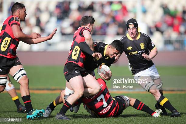 Vaea Fifita of Wellington is tackled by Tom Christie of Canterbury during the round two Mitre 10 Cup match between Canterbury and Wellington at AMI...