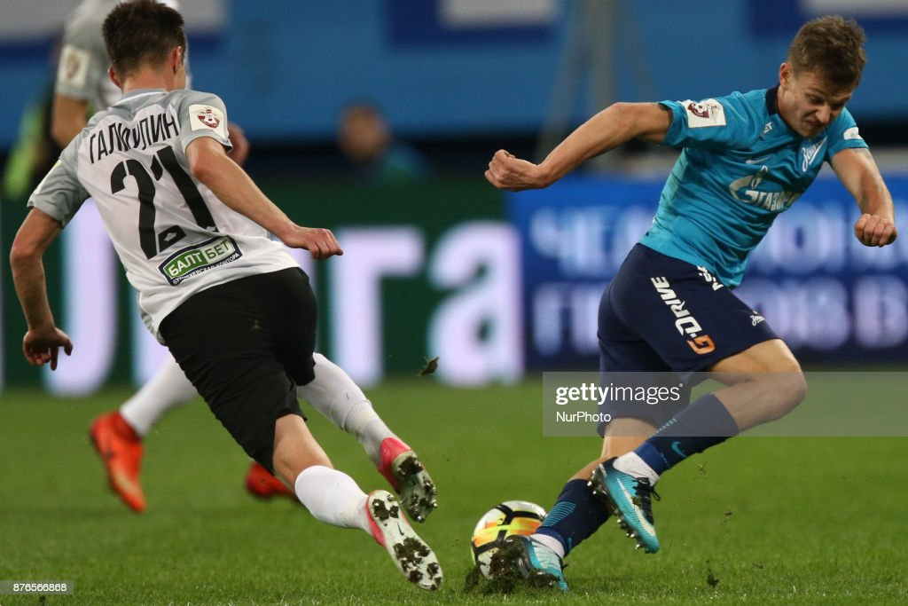 Vagiz Galiulin (L) of FC Tosno and Oleg Shatov of FC Zenit Saint Petersburg vie for the ball during the Russian Football League match between FC Zenit Saint Petersburg and FC Tosno at Saint Petersburg Stadium on November 19, 2017 in St. Petersburg, Russia.