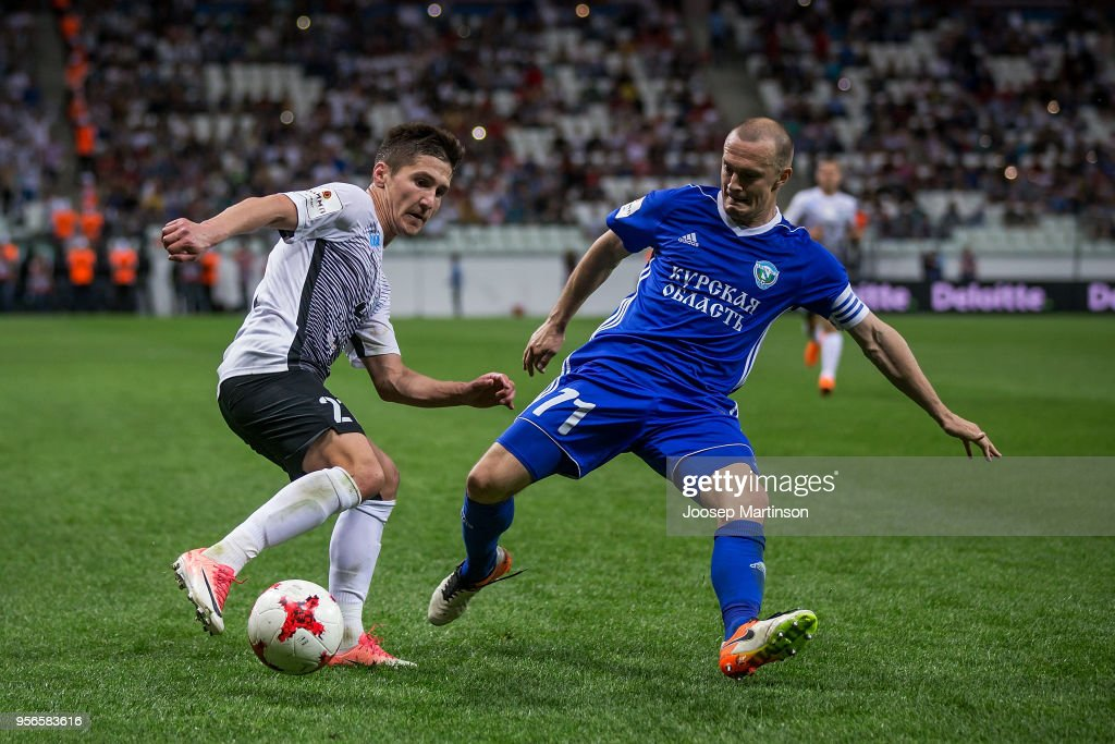 Vagiz Galiulin of FC Tosno competes with Mikhail Bagayev of FC Avangard during Russian Cup Final match between FC Tosno and Fc Avangard at Volgograd Arena on May 9, 2018 in Volgograd, Russia.