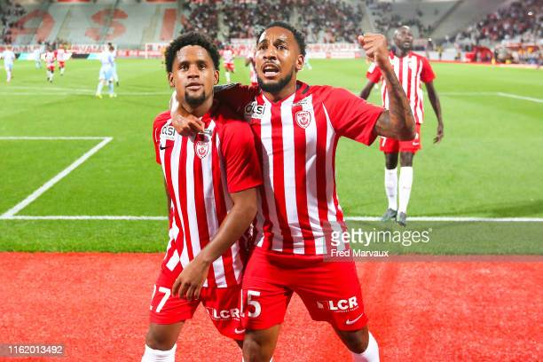 Vagner Dias Concalves of Nancy and Kenny Rocha Santos of Nancy celebrate during the Ligue 2 match between Nancy and Le Mans at Stade Marcel Picot on...