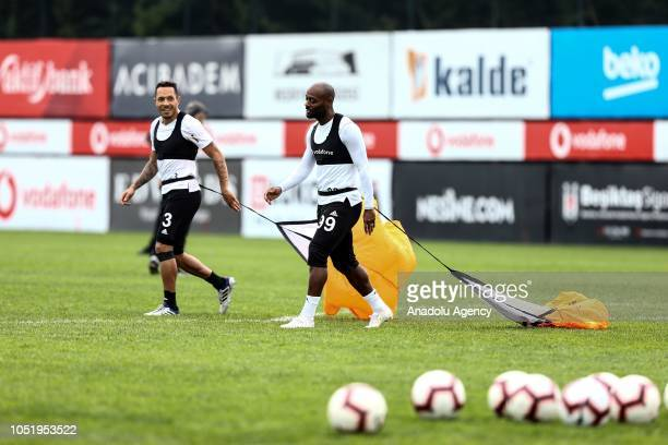 Vagner Love and Adriano of Besiktas attend a training session ahead of the Turkish Super Lig week 9 soccer match against Goztepe at Nevzat Demir...