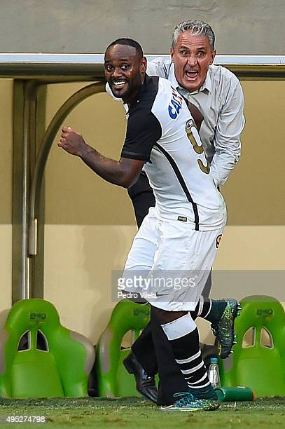 Vagner Love and Tite of Corinthians celebrates a scored goal against Atletico MG during a match between Atletico MG and Corinthians as part of...