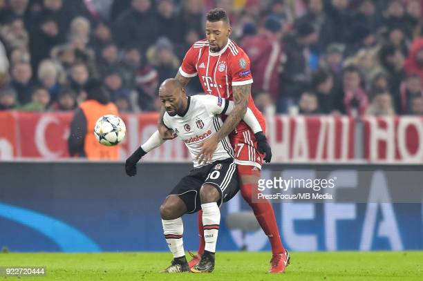 Vagner Love of Besiktas and David Alaba of Bayern Muenchen during the UEFA Champions League Round of 16 First Leg match between Bayern Muenchen and...