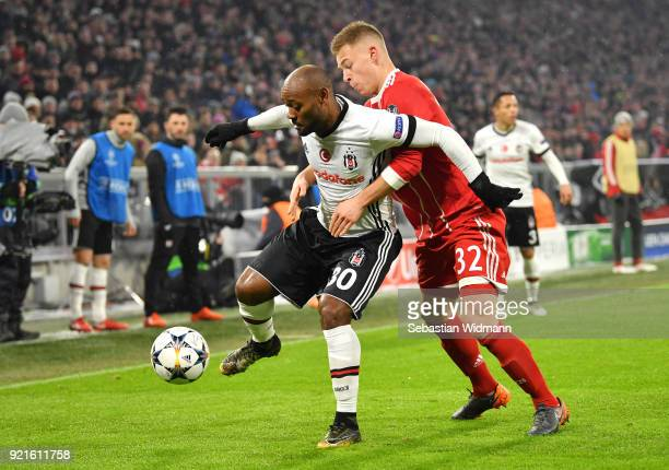 Vagner Love of Besiktas is challenged by Joshua Kimmich of Bayern Muenchen during the UEFA Champions League Round of 16 First Leg match between...