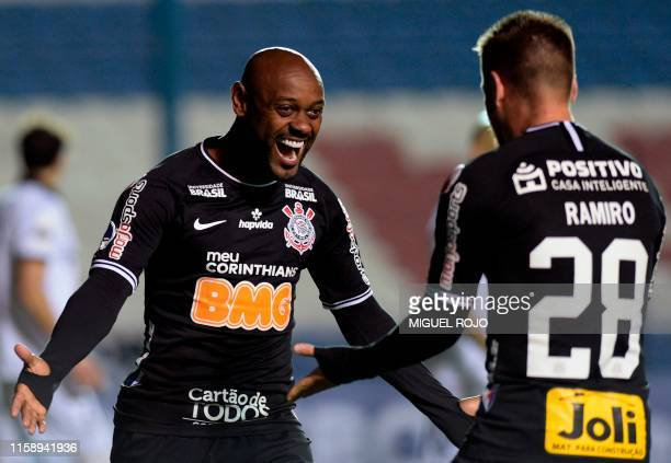 Vagner Love of Brazil Corinthians celebrates with Ramiro after scoring against Uruguay's Wanderers during their Copa Sudamericana football match at...