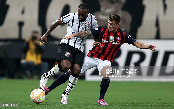 Vagner Love of Corinthians fights for the ball with Julio Buffarini of San Lorenzo during a match between Corinthians and San Lorenzo as part of...
