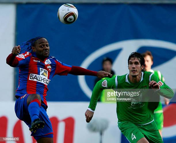 Vagner Love of PFC CSKA Moscow battles for the ball with Cesar Navas of FC Rubin Kazan during the Russian Football League Championship match at the...