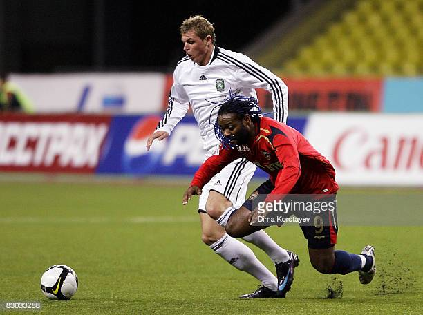 Vagner Love of PFC CSKA Moscow competes for the ball with Dmitri Tarasov of FC Tom Tomsk during the Russian Football League Championship match...