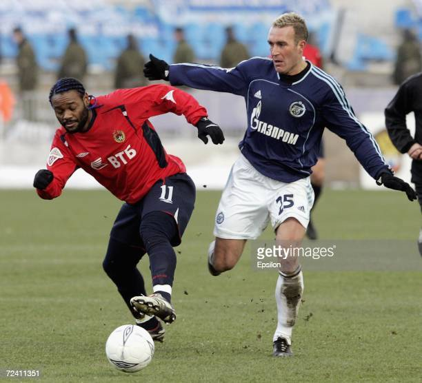 Vagner Love of PFC CSKA Moscow competes for the ball with Fernando Ricksen of FC Zenit Saint Petersburg during the Football Russian League...