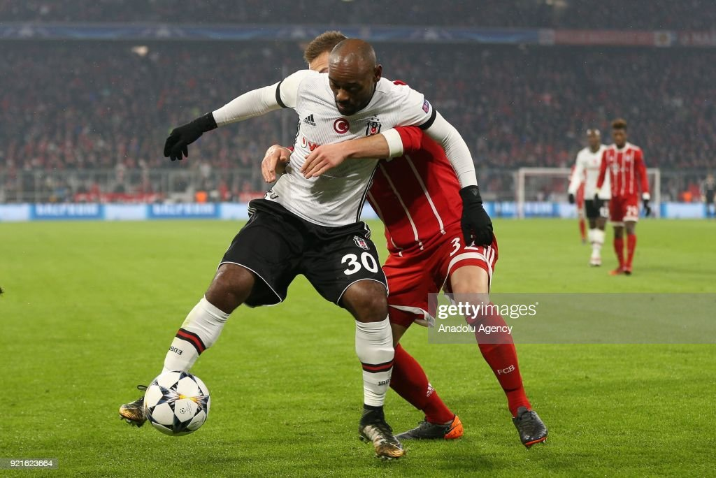 Vagner Silva De Souza of Besiktas (L) in action against Joshua Kimmich of Bayern Munich during the UEFA Champions League Round of 16 soccer match between FC Bayern Munich and Besiktas at the Allianz Arena in Munich, Germany, on February 20, 2018.