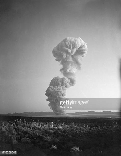 Vaguely resembling a question mark the mushroom cloud from the Operation Cue atomic blast rises over the Nevada desert May 5th The question mark was...