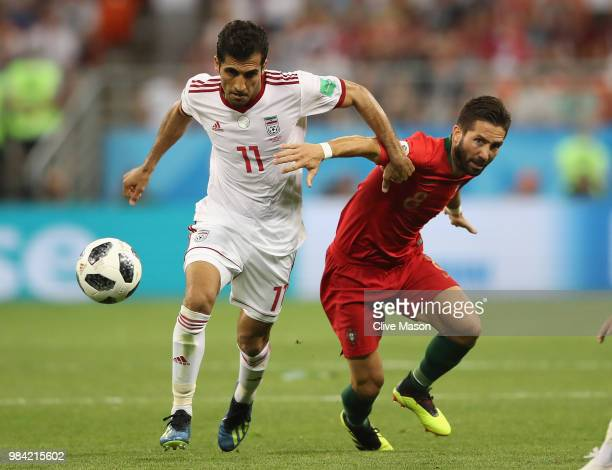 Vahid Amiri of Iran and Joao Moutinho of Portugal compete for the ball during the 2018 FIFA World Cup Russia group B match between Iran and Portugal...
