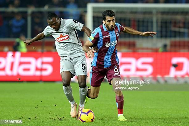 Vahid Amiri of Trabzonspor in action against Aminu Umar of Caykur Rizespor during Turkish Super Lig soccer match between Trabzonspor and Caykur...