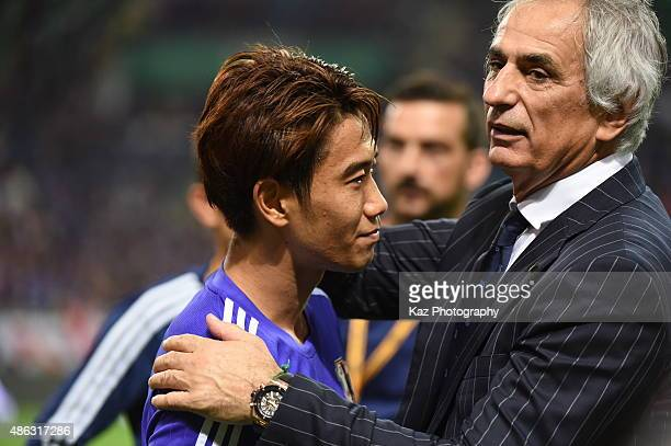 Vahid Halilhodzic coach of Japan holds Shinji Kagawa after the match [action] during the 2018 FIFA World Cup Qualifier Round 2 Group E at Saitama...