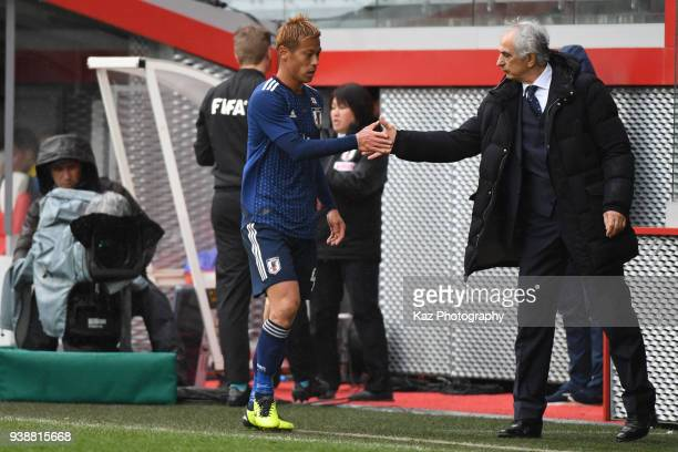 Vahid Halilhodzic manager of Japan shakes the hands with Keisuke Honda of Japan after subsititution at Stade Maurice Dufrasne on March 27 2018 in...