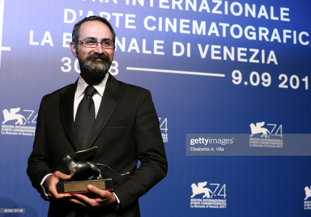 Vahid Jalilvand poses with the Orizzonti Award for Best Director and Orizzonti Award for Best Actor for 'Bedoone Tarikh, Bedoone Emza' at the Award Winners photocall during the 74th Venice Film Festival at Sala Casino on September 9, 2017 in Venice, Italy.