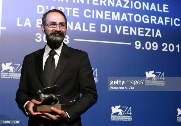 Vahid Jalilvand poses with the Orizzonti Award for Best Director and Orizzonti Award for Best Actor for 'Bedoone Tarikh Bedoone Emza' at the Award...