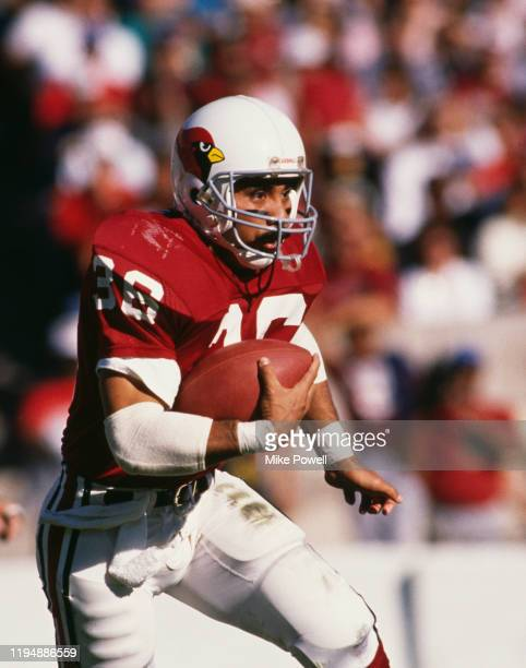 Vai Sikahema Running Back for the Phoenix Cardinals runs the ball during their National Football Conference East game against the Philadelphia Eagles...