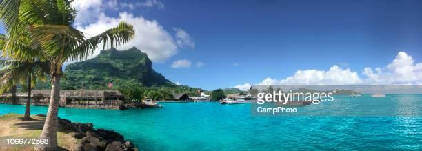 vaitape village panorama - caldera stock pictures, royalty-free photos & images