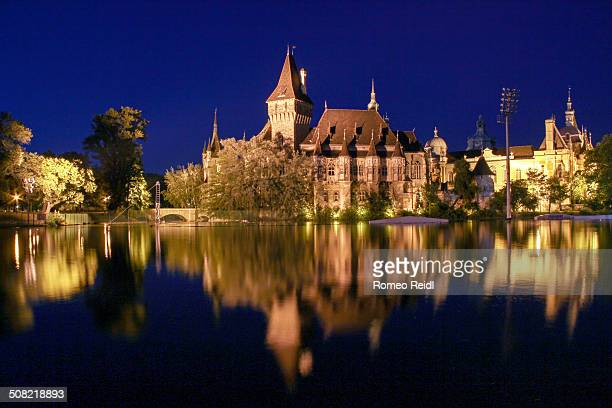 Vajdahunyad Castle is one of the romantic castles in Budapest, Hungary, located in the City Park by the boating lake.
