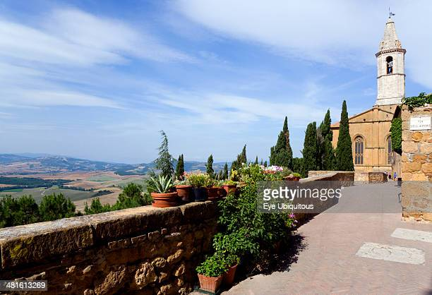 Val D Orcia The bell tower of the Duomo seen from the Via Dell Amore with cypress trees overlooking the countryside