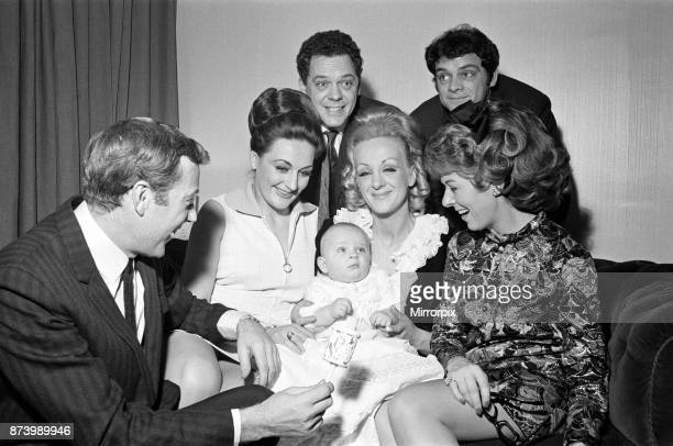 Val Doonican and his wife Lynn in supporting roles at the christening of baby Russell Beamont White The baby is the son of actor Arthur White who...