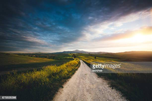 val d'orcia landscape - country road stock photos and pictures