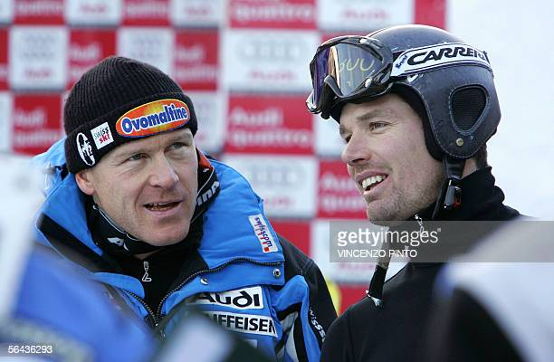 Bruno Kernen of Switzerland talks with his compatriot Didier Cuche in the finish area during the Alpine skiing World Cup men downhill training...