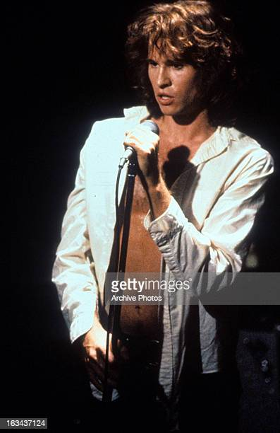 Val Kilmer at the microphone in a scene from the film 'The Doors', 1991.