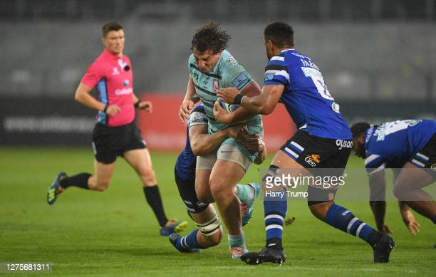 Val RapavaRuskin of Gloucester Rugby looks to break past Tom Ellis of Bath Rugby and Taulupe Faletau of Bath Rugby during the Gallagher Premiership...