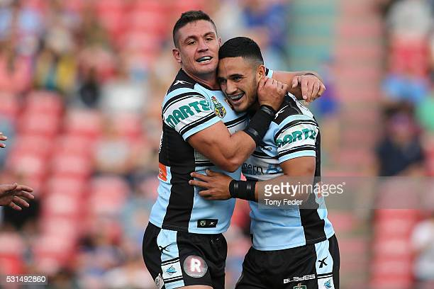 Valantine Holmes and Chris Heighington of the Sharks celebrate a try during the round 10 NRL match between the Newcastle Knights and the Cronulla...