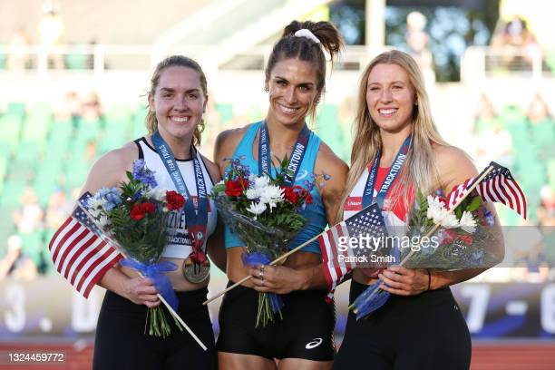 Valarie Allman , first, Micaela Hazlewood , second, and Rachel Dincoff, third, pose on the podium after the Women's Discus Throw Final on day 2 of...