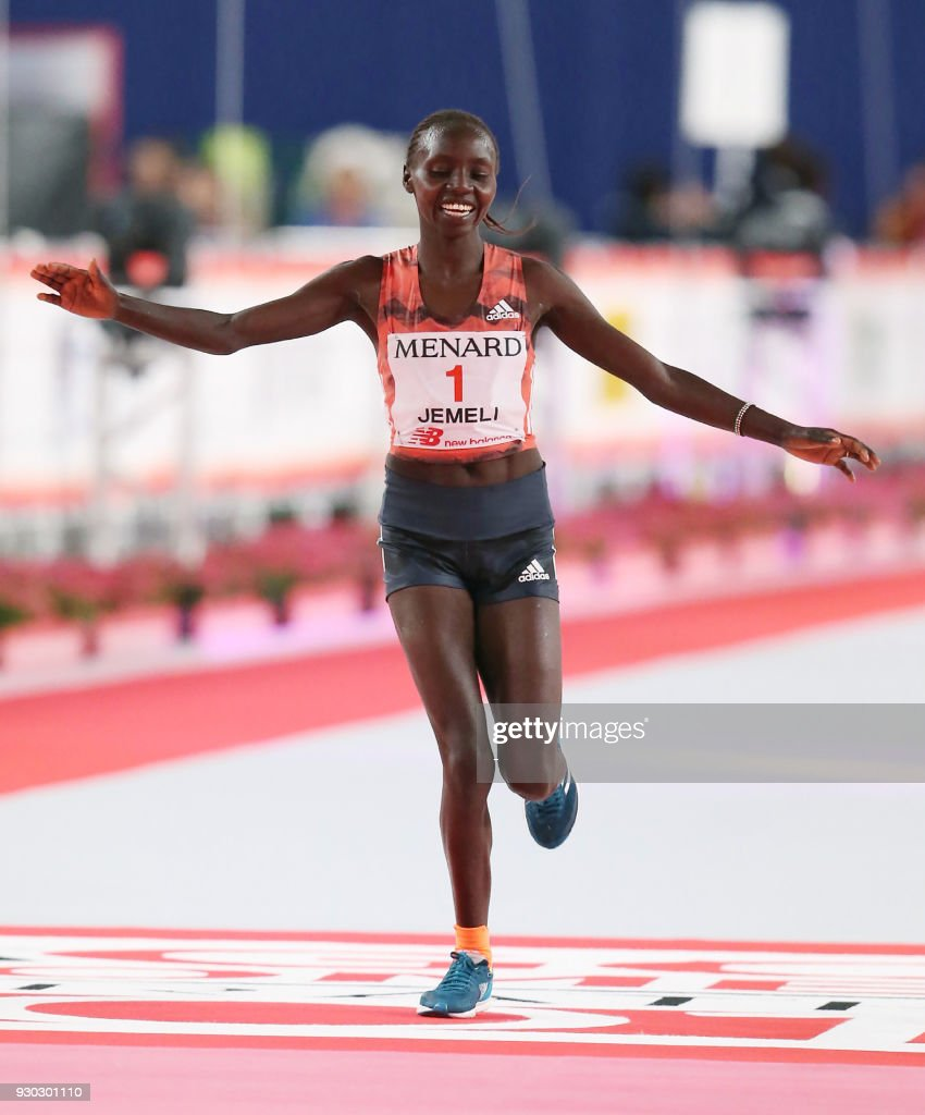 Valary Jemeli of Kenya crosses the finish line to finish in second place at the Nagoya women's marathon in Nagoya on March 11, 2018. / AFP PHOTO / JIJI PRESS / - / Japan OUT